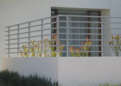 Kingsford Design 75x25 Rails welded to posts & core drilled into rendered wall Citi Pearl Brighton