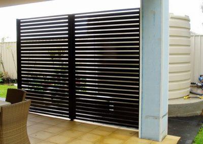 Leabrook Design; Horizontal Slats 65x16 with 10mm Gaps; Rain water tank screen; Satin Black; Onkaparinga Hills